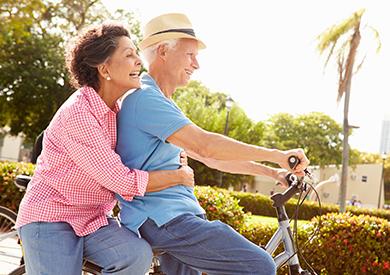 Seniors - Couple riding bike